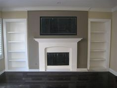 My dream Wall tv, books, candlesticks, photo frames, home decor galore :)