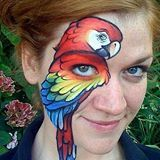 Arizona face painting.  I like this but I would want the girl's eye to be the parrot's.