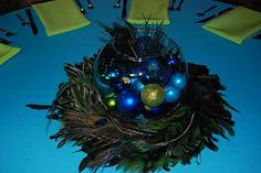 peacock feather wreath used as part of a centerpiece Peacock Wreath, Feather Wreath, Peacock Decor, Peacock Theme, Peacock Wedding, Peacock Feathers, Peacock Colors, Gold Wedding, Peacock Centerpieces
