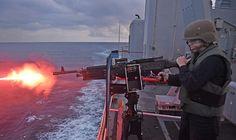 Logistics Specialist Seaman Nina Bowers from Mount Airy, N.C., fires a M240 machine gun on the amphibious dock landing ship USS Ashland (LSD 48).