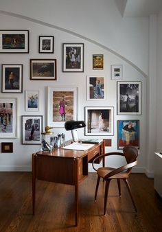 Walton uses this desk which she found on Etsy to create her fashion illustrations. Behind it is a second gallery wall...