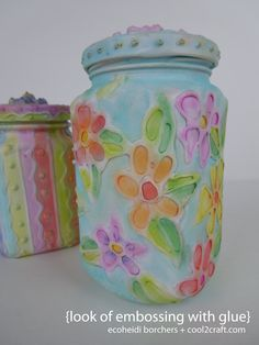 One of my fave vintage Momma Aleene's techniques. My sis EcoHeidi created the look of embossing with glue. Great way to upcycle glass jars!