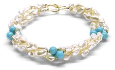 Helga Wagner Mother of Pearl Nuggets with three stations of Turquoise color mother of pearl beads and Tiffany clasp.
