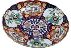 "This large porcelain platter is hand-painted in the traditional Imari pattern. Stamped ""Gold Imari"" on the underside."