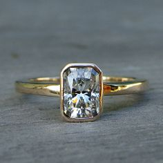 Forever Brilliant moissanite and recycled 14k yellow gold ring