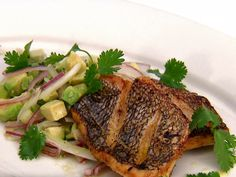 Crispy Skin Black Sea Bass with Avocado, Tomatillo and Fennel Relish from FoodNetwork.com. Bobby Flay's recipe