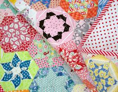 My sister, Rita from Red Pepper Quilts  has just blogged her beautiful Mother In Law's Hexagon Star Quilt.  I had the pleasure of quilting ...
