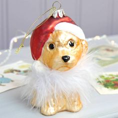 <ul> <li>Retro glass painted bauble with feather detail.</li> <li>Super cute labrador wearing a Christmas hat and feather collar.</li> <li>From the Lisa Angel Homeware Collection.</li> </ul>From baubles to bunting and all the ornaments and decorations in between, we've got your magical Christmas covered at Lisa Angel. Transform your home into a winter wonderland with our specially selected Christmas decorations and accessories, from tasteful and traditional to cool and contemporary, ...