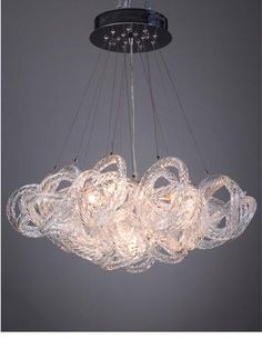The hand-blown glass Infinity fixture from Viz Glass comes in 3 colors: chrome, crystal and champagne. #lvmkt A306. www.vizartglass.com