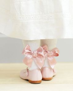 Keep little legs warm for a winter wedding with these embellished tights. Just sew pretty satin bows to the backs of her stockings for added cute points (score extra by matching the color of the ribbon to her shoes).