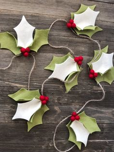 A beautiful handmade felt holly garland that is perfect for a photo prop, to place across a mantle, or to decorate your home this Christmas! Each holly bunch has three felt leaves and three red holly berries. This garland is is 5 feet long with 6 holly bunches and comes ready to hang!