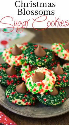 Christmas Blossoms Sugar Cookies with Hershey Kiss (Best Christmas Snacks) Best Christmas Cookie Recipe, Christmas Cookie Exchange, Christmas Sugar Cookies, Holiday Cookies, Christmas Recipes, Holiday Recipes, Christmas Deserts, Holiday Desserts, Holiday Baking