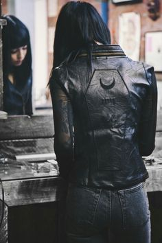 leather jacket with mesh sleeves and coffin/moon embroidery on back panel #InsurgentLook