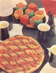 Canned spaghetti pizza! And baked bean stuffed peppers! What's in the mugs, Cream of Mushroom Soup?