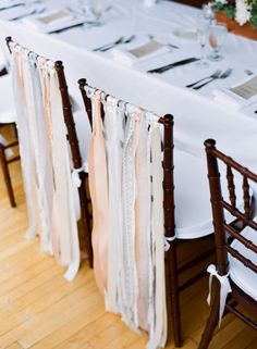 Ribbon or torn strips of fabric hung from chairs