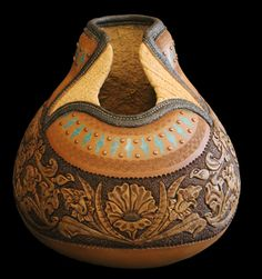 jordan straker ~ gourds... so many ways to play... more gourd art http://www.jordanstraker.com/gourds2.html and craft here http://pinterest.com/parkfran/natural-arts/