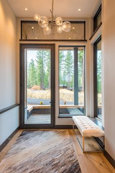 Grand entry to this mountain modern vacation home designed by Emily Esposito of E. Esposito Interiors in North Lake Tahoe, California. Modern Entry, House Viewing, Mountain Modern, Interior Photography, House Rooms, Home Interior Design, Custom Homes, Foyer, Home Furnishings