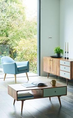The Juno armchair in sky blue. Inspired by a vintage chair spotted by our designer, it's the reclining back and seamlessly sloping arms of the Juno that gives its svelte Scandi shape lounge-like appeal – use anywhere from the living room to the bedroom for relaxed sophistication. Also featuring the Otto coffee table.