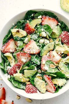Fresh strawberries, sliced avocados, slivered almonds and sprinkled with feta cheese all tossed with a spinach salad then drizzled poppyseed dressing mixed toge Strawberry Avocado Salad, Avocado Spinach Salad, Spinach Salad With Chicken, Spinach And Feta, Spinach Salads, Recipe With Spinach, Best Nutrition Food, Large Salad Bowl, Healthy Salad Recipes