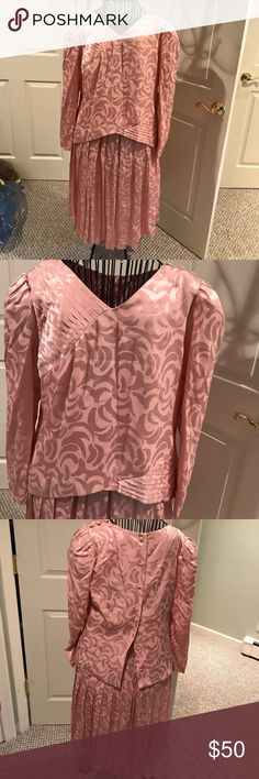 2 pc vintage silk outfit from Neiman Marcus 12 Pink silk jacquard. Classic 80s outfit with shoulder pads. Pleated skirt. Some oblique accent pleating on top. Bought for mother of bride but never worn. A great shape. Makers label absent but bought in Nean Marcus vintage Dresses