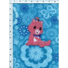 A charming Care Bear sits sweetly on a blossom, surrounded by a blue sky of flowers and butterflies in this FLEECE fabric. www.americasbestthreads.com