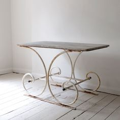 Simple and elegant early 20th century pattisserie table from Puckhaber Antiques on the DC