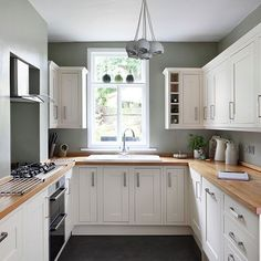 Brighton penthouse on the market for but it has a HUGE secret White and sage green kitchen Small kitchen design ideas PHOTO GALLERY 25 Beautiful Homes u. Green Country Kitchen, Sage Green Kitchen, Kitchen White, Cream And Grey Kitchen, Green Kitchen Walls, Country Blue, White Kitchen Paint Ideas, Cream Kitchen Cupboards, Cream Shaker Kitchen