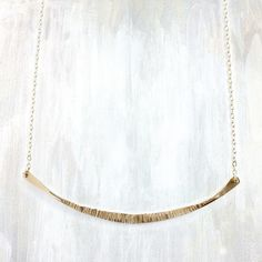   a simple everyday necklace with an eye catching hammered texture   available…