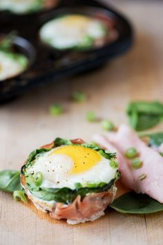 Total time:  30 mins Serves: 6  350F 6 slices of ham 18  spinach leaves 6 tsp goat cheese 6 eggs 6 tsp milk 2 tsp chopped chives ⅛ tsp black pepper Spray 6-cup muffin tin with cooking spray. Line with ham. Place three spinach leaves over ham, then 1 teaspoon of goat cheese over spinach. Carefully crack an egg over top. Spoon 1 tsp of milk over each yolk. Sprinkle chives and pepper over top. Bake until whites are set, about 18-20 minutes. Run knife around inside of each muffin cup, then remove.