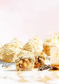 These Apple Pie Stuffed Chai Spiced Cupcakes are vanilla cupcakes spiced with a homemade chai spice mix, filled with a chai spiced apple pie filling and topped with rich salted caramel frosting.