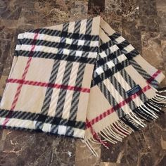 Burberry Cashmere Scarf Like New Burberry Check scarf in excellent like new condition. Beautiful pattern. 100% cashmere. I purchased when I lived in Oxford at the London Harrods store. Burberry Accessories Scarves & Wraps