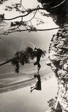 Stunt man Luciano Albertini venturing his life and that of a fellow player for tension in the film, 1923