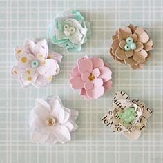 Make these tiny paper flowers to adorn all your crafty projects!