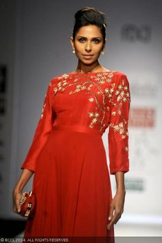 Candice Pinto walks the ramp for designer Nikasha on Day 2 of Wills Lifestyle India Fashion Week (WIFW) autumn-winter (AW) 2014, held in Delhi, on March 27, 2014.