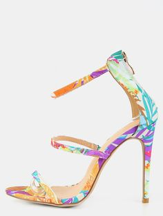 """No time for a vacay? No worries! Get your tropical fix with the Tropical Triple Strap Single Sole Heels! Features an open toe, fabric upper, triple strap design, back zipper, and vibrant pattern. Finished with a slightly padded insole, and a 4.25"""" stiletto heel approx. Pair with wide leg trousers and a crop top for an exciting ensemble!"""