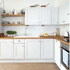 Kitchen Interior Remodeling Modern white kitchen with wooden floor and worktops - Kitchen design ideas for your next project. We have all the kitchen planning inspiration you need for the heart of your home - whatever your style and budget Kitchen Cabinets Decor, Kitchen Cabinet Design, Kitchen Flooring, Kitchen Wood, Kitchen White, Kitchen Corner, Kitchen Ideas, Cabinet Decor, Kitchen Pictures