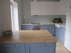 Yael & Birgitte's Norwegian Kitchen — Small Cool Kitchens 2013 - stainless range w/ white fridge - white uppers, blue-grey lowers