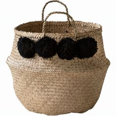Beautiful natural handwoven sea grass baskets with black pom poms.  You can use these basket at many ways they can cheer up every room in your house, but you can also use them for a original beach or picnic bag  Wonderfully soft and lightweight yet hard wearing and can hold a surprising amount. They also have the great feature of folding in the middle to create a lovely bowl shape.  Available in large.  Basket dimensions: Large - Diameter 45cm/18inches, Height 35cm/14inches (45cm&#x...