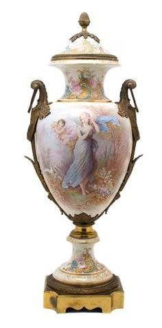 A Sevres Style Gilt Bronze Mounted Urn and Cover,