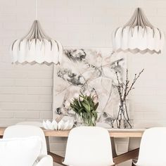 This white interior makes a statement with two Peony lamps above the wooden dining room table / be&liv Beautiful Lights, Ceiling Lamp, Dining Room Table, Peony, Lamps, Contemporary, Lighting, Interior, How To Make