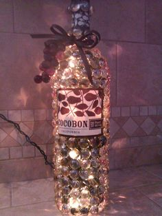 decorated lighted wine bottle