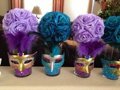Having alternating tall and short center pieces makes the . Having alternating tall and short center pieces makes the … Masquerade Party Centerpieces, Masquerade Ball Party, Sweet 16 Masquerade, Masquerade Wedding, Masquerade Theme, Mardi Gras Centerpieces, Wedding Centerpieces, Sweet 16 Centerpieces, Graduation Centerpiece
