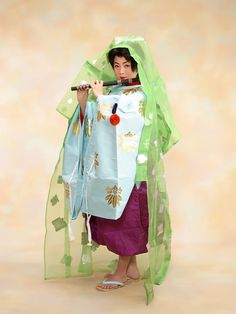 A boy dressed in heian robes.
