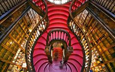Stairs and shelves at Lello Bookshop in Porto, Portugal.