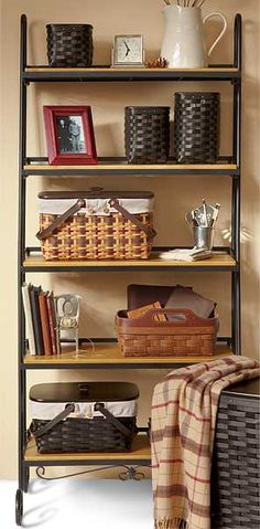 """Longaberger Wrought Iron Leaning Bookshelf-71517 Wrought Iron Leaning Bookshelf works perfectly in every room of your home to help you decorate and organize all in one. The Bookshelf accomodates 5 optional WoodCrafts Shelves, available separately. Add Stow Away Baskets for all of your organizing needs. Assembly required; hardware and detailed instruction sheet included. 30 1/2""""l x 19""""w x 69""""h; Rec. Wt. Use: 300 lbs."""