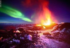 Northern Lights behind the glowing lava of the Fimmvorduhals volcano in Iceland.