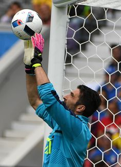 Italy's goalkeeper Gianluigi Buffon stops a ball as he warms up before the Euro 2016 group E football match between Italy and Sweden at the Stadium...