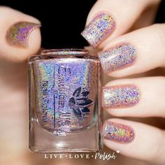 Emily de Molly This Moment Nail Polish Emily de Molly This Moment is a rose gold holographic polish with blue metallic flakes and holographic microglitter.