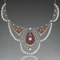 """An Edwardian plique-a-jour enamel, diamond and natural pearl necklace, circa 1905. Composed with lace-like delicary, allowing light to permeate with a brilliant """"stained glass"""" effect, set iwth approximately 5.00 carats of diamonds and natural pearls, mounted in platinum and 18k gold."""