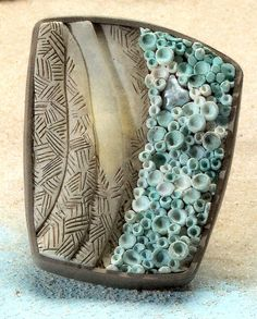 Designed by Lori Wilkes.  She has a full tutorial for this in the June issue of Bead & Button magazine.